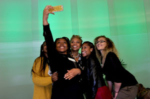 Four MA students take a selfie with Mayor Redd