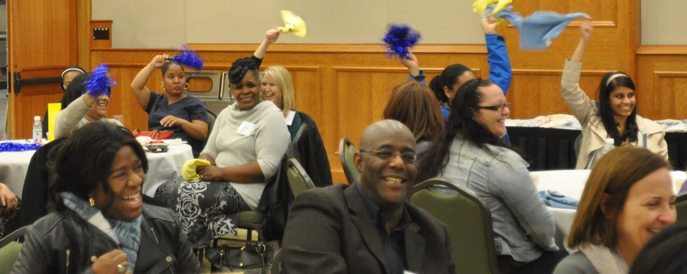 ACO members cheering for their teams at a recent dinner event