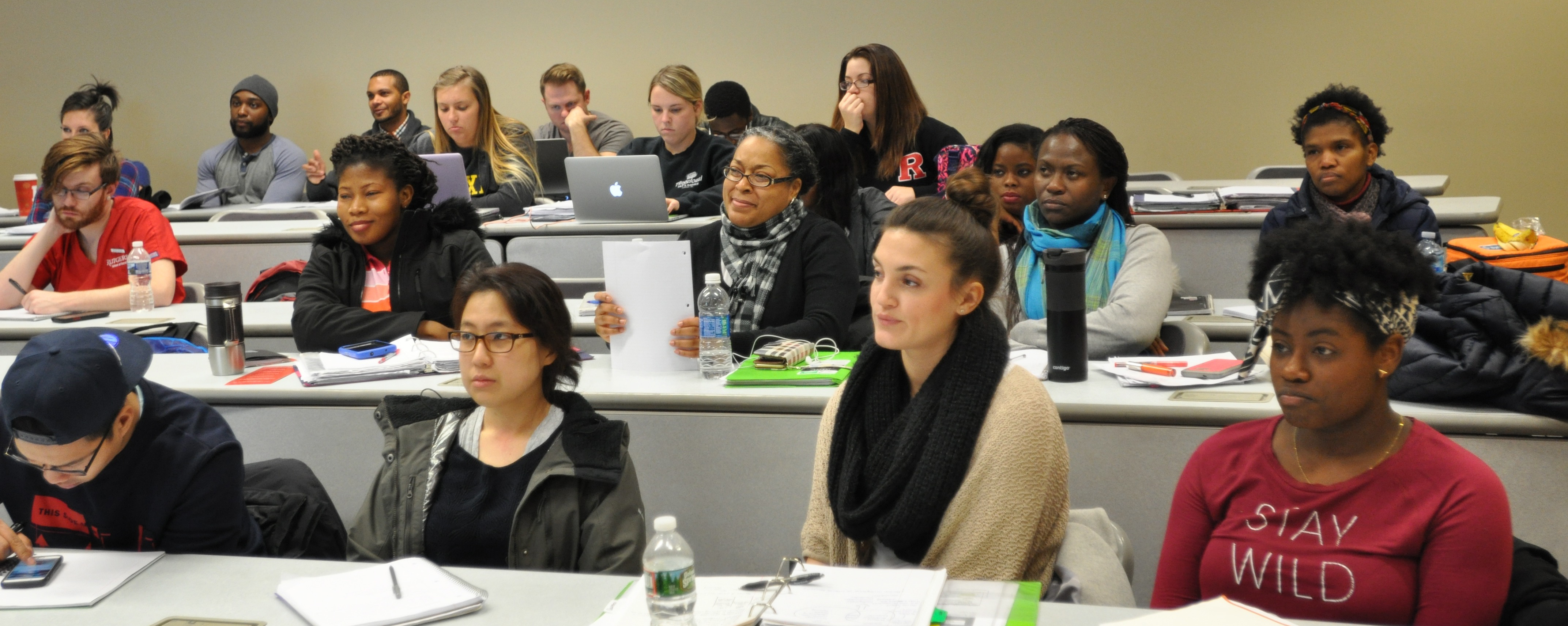 Rutgers nursing students listen to Coalition care team members talk about teaming and patient care
