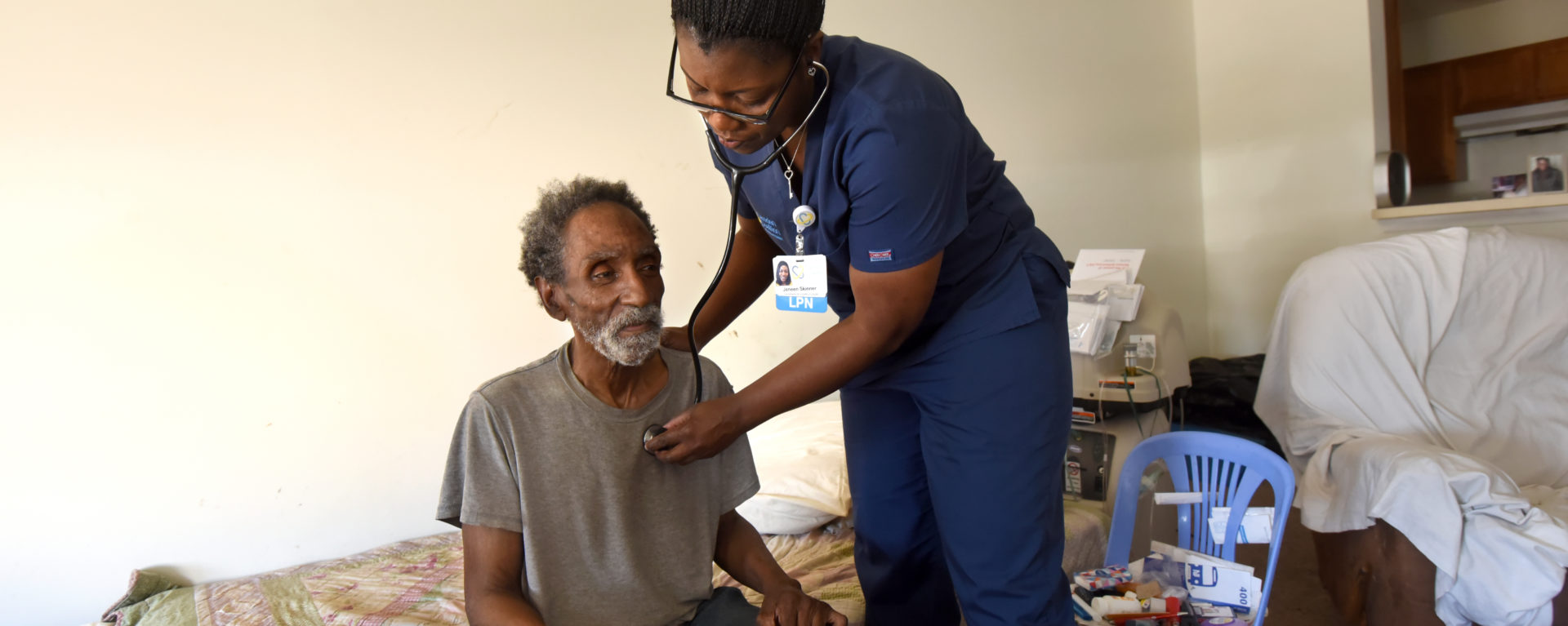 Jeneen Skinner listens to a patient's lungs during a home visit