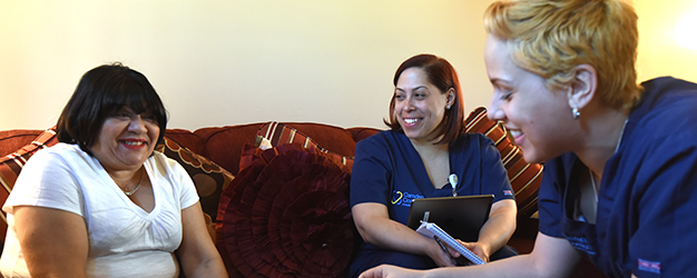 Care team visits patient at home