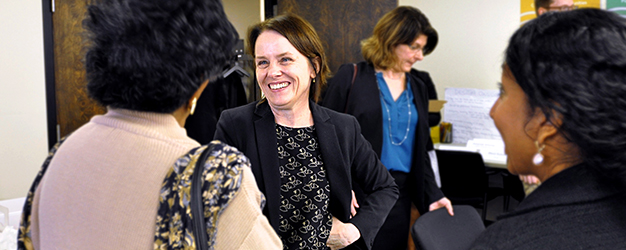 Camden Coalition CEO Kathleen Noonan chats with a board member