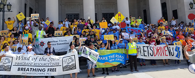 A large crowd of New Jersey residents rally in front of Trenton State House to show support for a bill expanding access to driver's licenses to more residents.