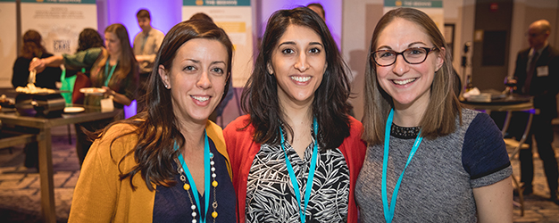 Complex Health and Social Needs Fellow Rebecca Shames, pictured right, smiles with Kimberly McGuinness (left) and Tina Ahmadinejad (center) at the Putting Care at the Center 2018 conference Beehive event.