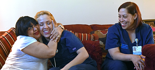 Patient gives Camden Coalition care team member a hug during a home visit