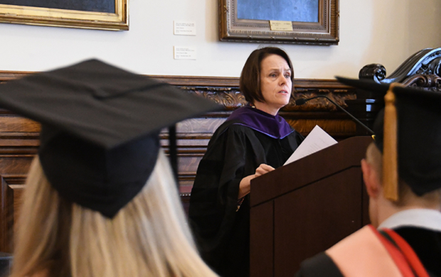 Kathleen Noonan speaking to graduates in caps and gowns