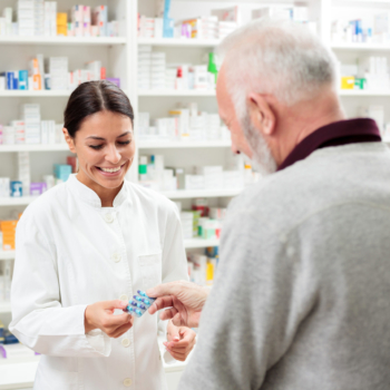 Pharmacist helps elderly patient with medications