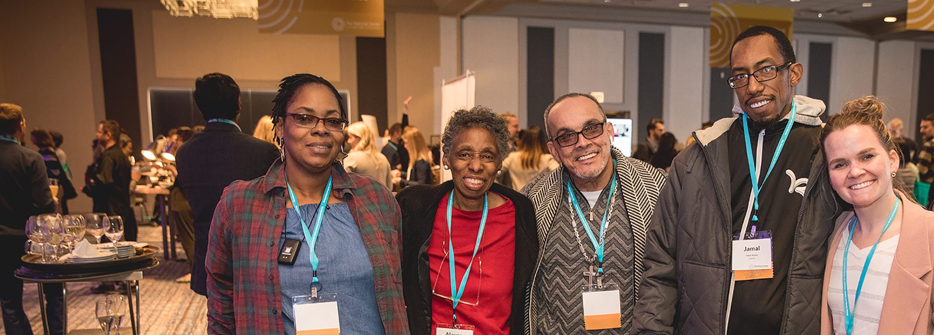 A group of National Consumer Scholars smile for the camera at one of our annual conferences