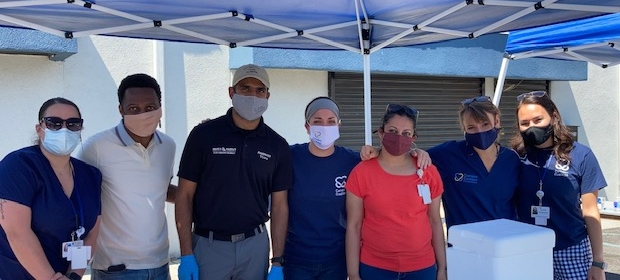 Camden Coalition staff and partners pose together at COVID-19 vaccine event